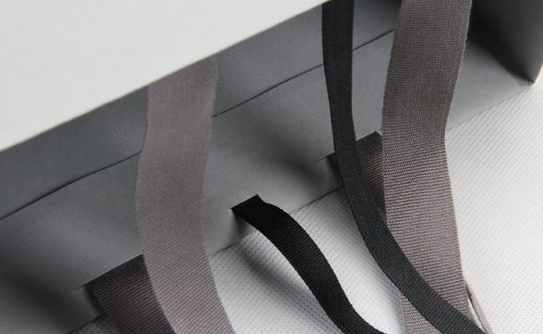 Premium Grey Garment Paper Bags With Hot Stamping Logo handle