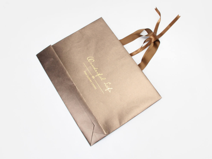 Bright Gold Iridescent Paper Shopping Gift Bags Folding Display