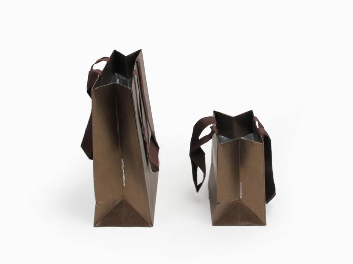 Fantastic Iridescent Garment Shopping Paper Bags Side Display