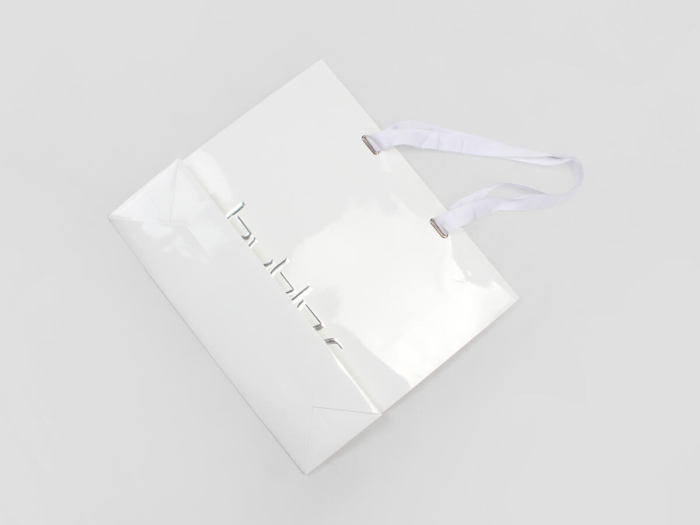 Garment Paper Bags With Ribbon Hoop Bottom Display