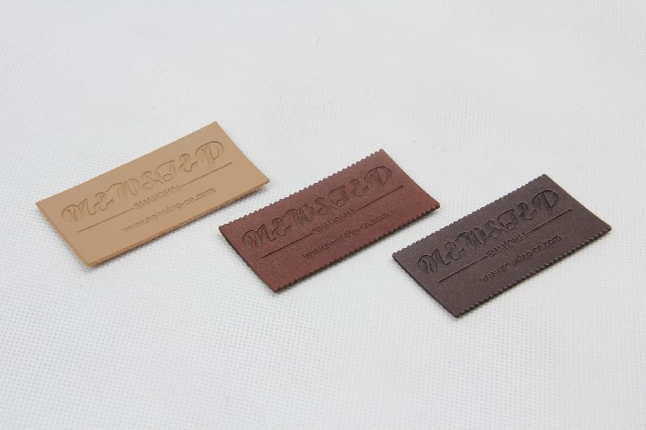 Premium PU Leather Clothing Woven Labels Tags side