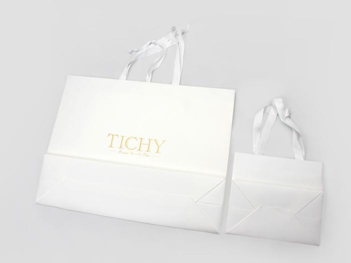 Premium Women Full Embossing Paper Garment Shopping Bags Bottom Display
